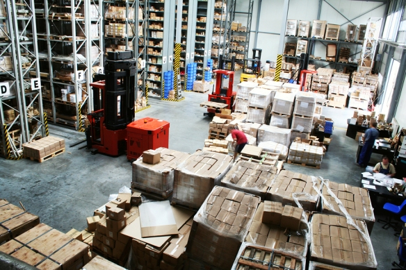 bigstock-Full-warehouse-with-forklifts--16555610